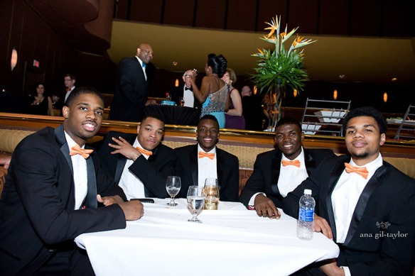 Part of the SU Basketball team relaxing before taking pictures with guests