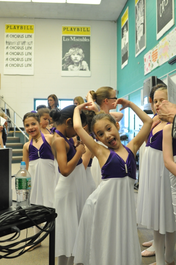 Ballerina getting ready to perform- being silly in the front